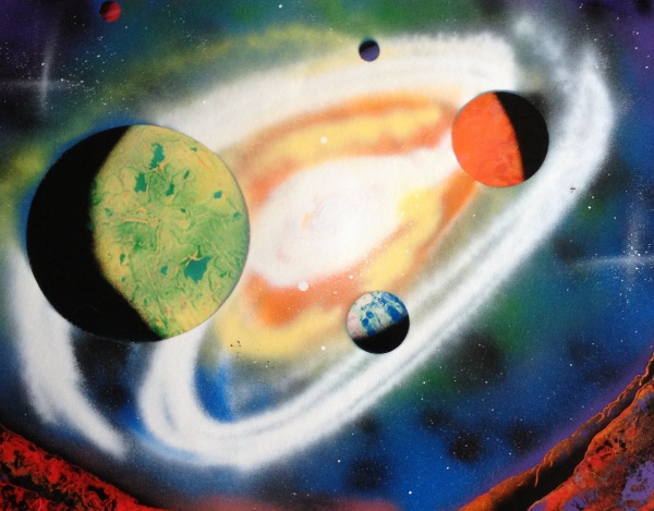 spray paint art five planets and big swirling galaxy